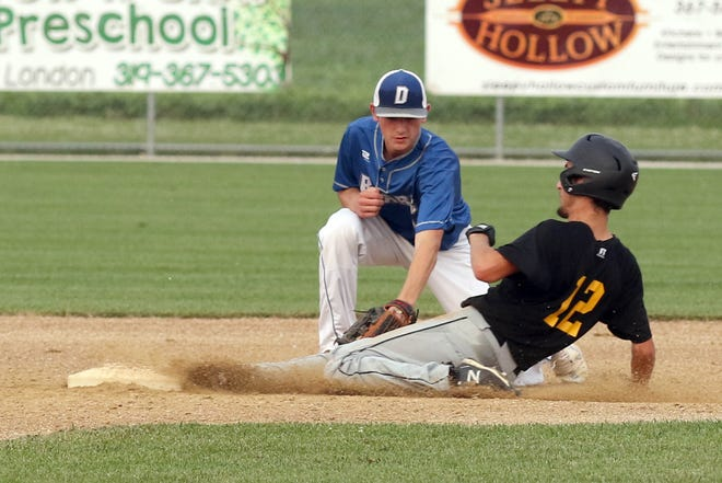 New London Tigers' Seth Bailey slides into second safely for a stolen base as Danville's Jaden Bauer applies the tag during the Class 1A district semifinal in New London on Tuesday.