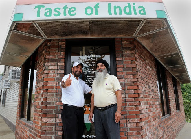 Brothers Joga, left, and Jarnail Singh celebrate 30 years in business at Taste of India on Main Street in Dover.