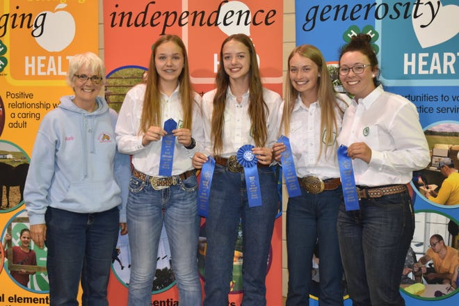 The Pierce County team took first place in the senior division of the hippology contest. Pictured are, from left: coach Barb Rice and team members Joey Wolf, Kendra Leier, Mika Guty and Tianna Dwyer.