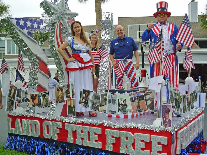 Riding the lead float in the Sawgrass Country Club July 4 golf cart parade was membership director Karen Schoen-Kiewart (from left), Ashley Lorey from accounting, general manager C. W. Cook and assistant general manager Perry Kenney. The float featured photos of Sawgrass members who were veterans.