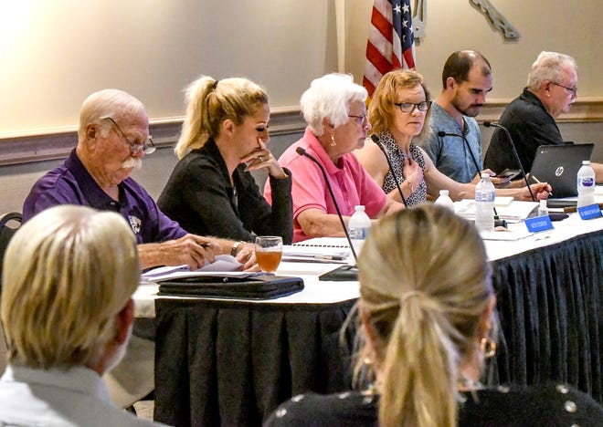 Members of the Garden City Community College Board of Trustees conduct their monthly meeting Tuesday in the Endowment Room at GCCC's Beth Tedrow Student Center.  This was the board's first in-person meeting since the start of the COVID-19 pandemic.