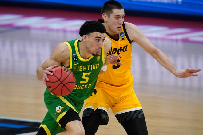 Oregon guard Chris Duarte (5) drives on Iowa guard CJ Fredrick during the second half of a game in the second round of the NCAA tournament at Bankers Life Fieldhouse in Indianapolis on Monday, March 22, 2021.