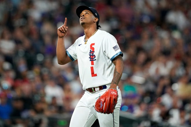 National League's Alex Reyes, of the St. Louis Cardinals, points upward after an out during the eighth inning of the MLB All-Star baseball game on Tuesday, July 13, 2021, in Denver.