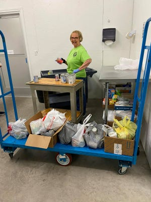 First United Methodist Church VBS recently made a donation of canned goods to Papas Pantry. Thank you to Paster Owen McKnight for enduring a pie in the face for his efforts. Here, volunteer Debbie Reynolds is unpacking and sorting the donation.