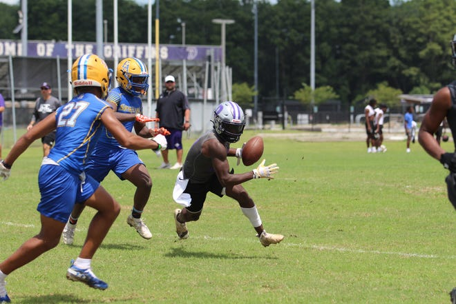 Dutchtown All-State running back Dylan Sampson makes a catch against East Ascension during Tuesday's seven-on-seven session.