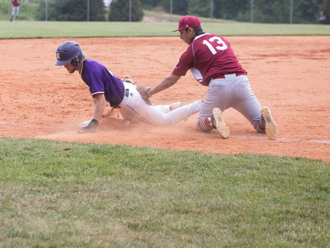 North Henderson's Brayden Corn slides safe into third under Asheville's Amrit Brown's tag in a game earlier this season at North.
