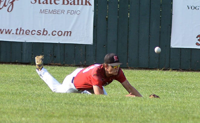 Newton Junior Knight Isaac Klug lays out his body to try and catch a fly ball during play Tuesday at Klein-Scott Field.