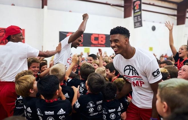 Jarrett Culver (center) celebrates with participants Wednesday, July 14, 2021, during his Jarrett Culver Camp held at the Apex Event Center in Lubbock.