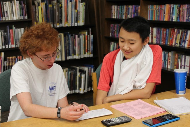 A student is tutored through the Robin's Nest program during a recent session at the Patterson Branch library in Lubbock.