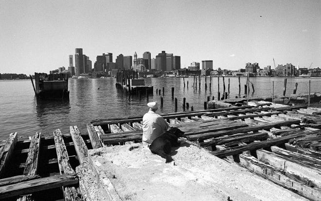 A resident enjoys the view from the East Boston waterfront outside Maverick Square in 1992.