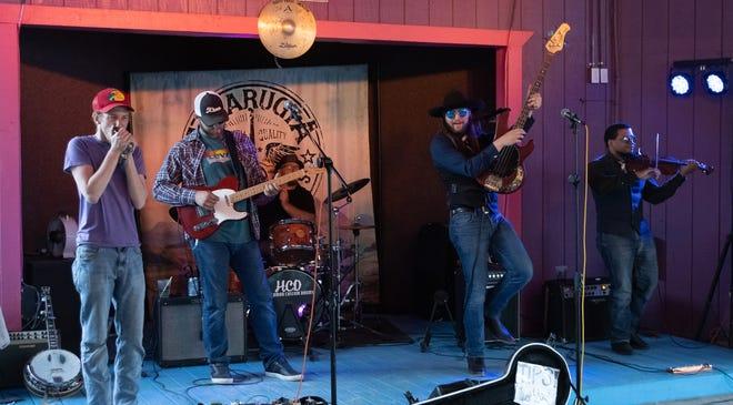The Amarugia Ridge Runners: Michael Turnbo, fiddle; Jesse Bauerle, bass; Clay Dahman, guitar; Alan Voss, drums; (back row) John Allin (banjo).