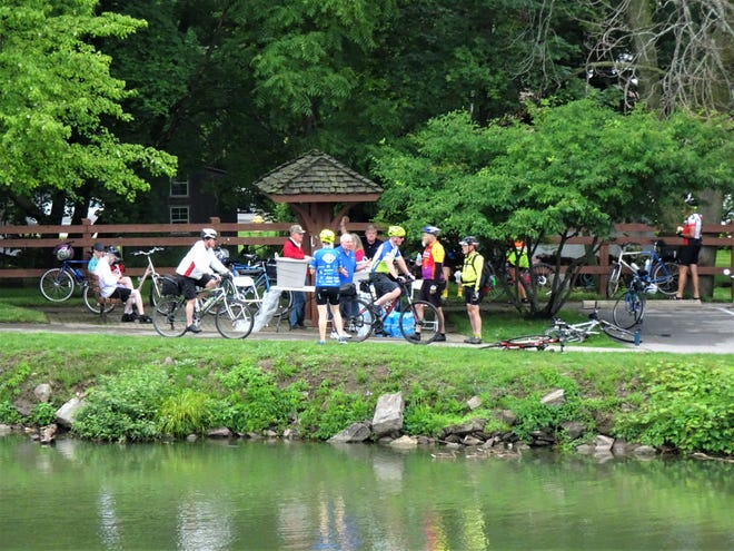 Cycle the Erie Canal bicyclists make a stop in Spencerport on their way from Buffalo to Albany.