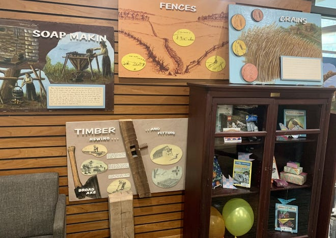 The Honeoye Falls-Town of Mendon Historical Society loaned five history boards and a hewn log for display at Mendon Public Library, 22 N. Main St., which will be up throughout the summer reading program for patrons to learn about the history of timber hewing, soap making, fences, grains and oxen that are part of the area's history.