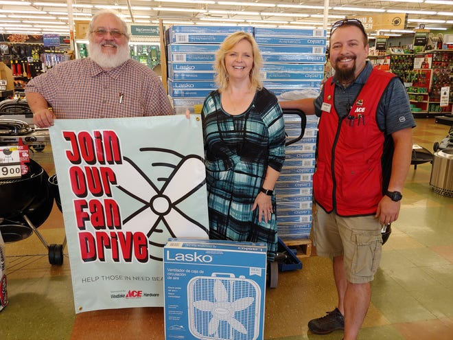 On behalf of the Salvation Army Service Unit in Moberly, Roy Morales-Kuhn, right, and Paula Heath, middle, are shown with Westlakes Ace Hardware store general manager Drew Holmes in accepting 57 electric floor fans from the Moberly business on July 13 as part of the company's nationwide Fan Drive. The floor fans will be distributed by the Salvation Army to persons in need to help give them comfort during excessive heat. Nearly $875 in customer donations at the Moberly store benefited the program. To learn more about the local Salvation Army Service Unit, contact Morales-Kuhn by calling 263-0094.