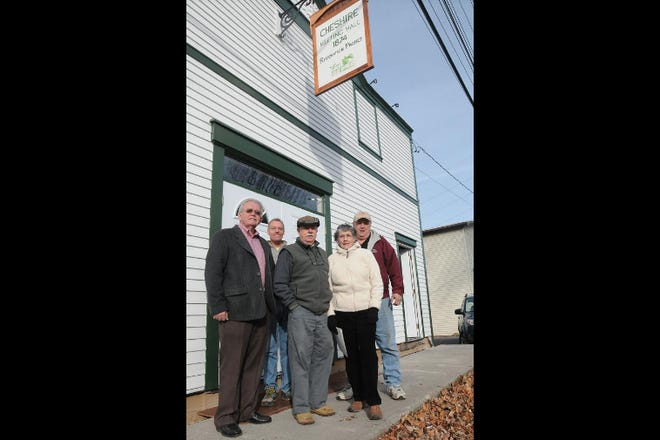 In this Nov. 28, 2011 file photo, members and supporters of the Cheshire Community Action Team, including (from left to right) Ontario County Historian Preston Pierce, Jim Rose, board member Fred Goodnow, Nancy Goodnow and Al Cooper stand in front of the Cheshire Grange, a historic building the nonprofit is focused on restoring. The nonprofit elected four new officers Thursday, July 8.