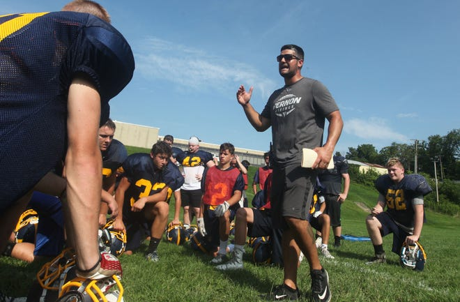 Vernon head football doach Steve Down talks to his team during a practice on Wednesday, Aug. 8, 2018, at Vernon Township High School.