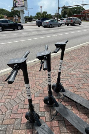Bird Rides rental scooters sit on the sidewalk near the intersection of Eglin Parkway and Hollywood Boulevard in Fort Walton Beach. The scooters are available for anyone to use and can be found at locations that include the Fort Walton Beach Police Department, Brooks Street across from Fort Walton Landing, Ferry Park, Uptown Station and this location in front of the Northwest Florida Daily News. building.