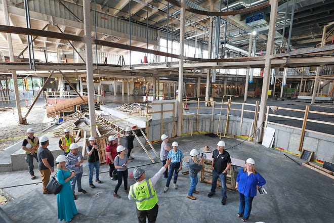 A group gets a look the atrium area of the new Chapman Middle School in Weymouth on July 14.