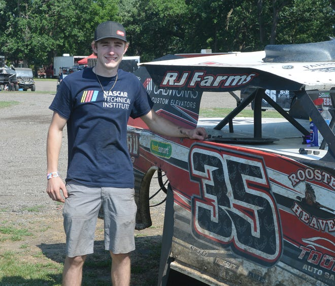 Second-year driver Ethan Weber stands next to his modified racer. Weber plans on attending the NASCAR Technical Institute at Mooresville, N.C. in August.