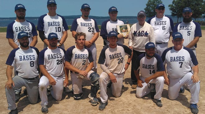 BASES of Charlevoix claimed an overall tournament win in the annual Dick Bare Invitational with Bare (third from back right) in attendance. Team members include (front, from left) Keith Young, Nick Hancock, Chase Lepird, Zack Peters, Randy Trepanier, Scott Kelly (back) Tyler Flynn, Will Friend, Brett Williams, Jake Phillips, Dick Bare, Jason Peters and Mike Britton.