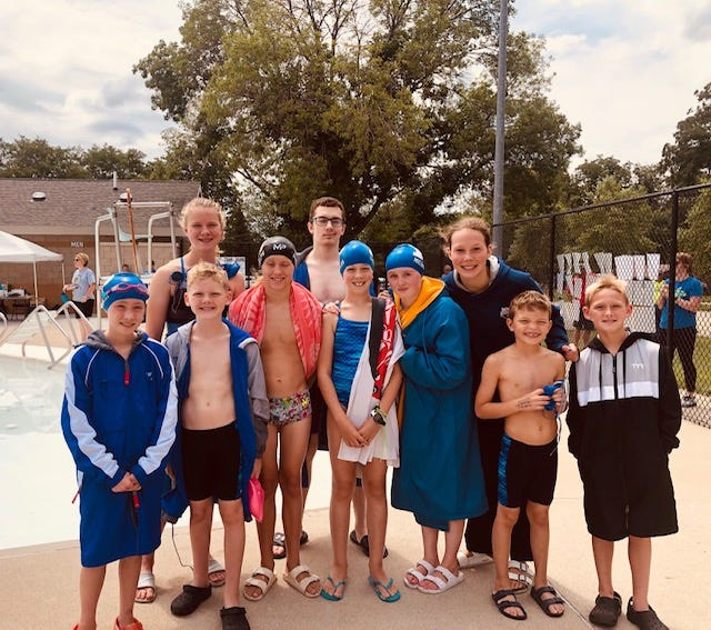 The 2021 Perry Summer Swim Team and Iowa West Swim Conference All Stars include, front row, Lillian Lucht, Dysen Deardorff, Townes Wilson, Aleah Karolus, Sophia McDevitt, Ray Hughes and Renaud Deardorff. Back Row- Jaylene Karolus, Andrew Dowd and Quin Mahler-Moreno. Not pictured, Zoe Hibbert and Riese Archer.