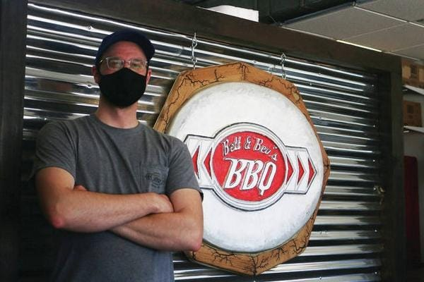 Kyle Roeder poses for a photo inside the Bett and Bev's BBQ Perry location in May of 2020. The restaurant will hold an outdoor event from 5-9 p.m. July 17 with a hog roast and live band.