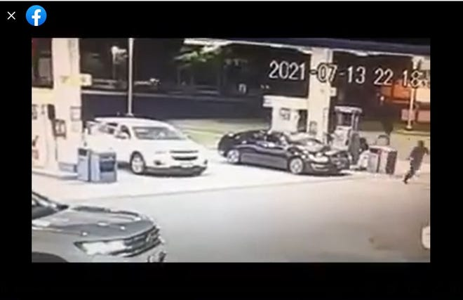 This image is from surveillance video that Marlow Jones posted on his Facebook page after he was robbed at gunpoint while pumping gas in Petersburg Tuesday, July 13, 2021. He can be seen in the upper right of the image running away from his car toward South Crater Road.