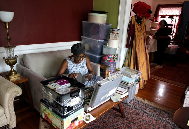 Rose Weaver sorts through a one of many CD cases that contain music of her favorite artists and also collections of her own performances recorded over the years from Trinity Rep and other venues. She is packing up her Providence apartment for her move to Georgia.