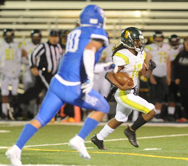 Franklin's Richard Turner runs the ball towards the end zone during their game March 19 in Stockton.