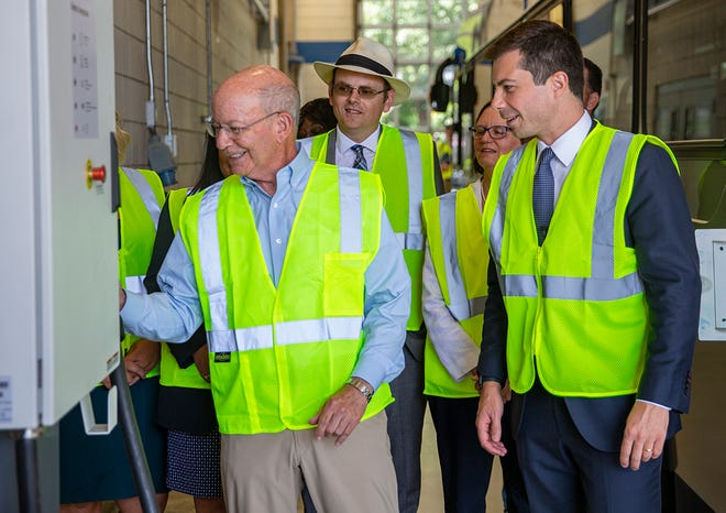 Congressman Peter DeFazio, from left, Mayor Sean VanGordon, Mayor Lucy Vinis and U.S. Secretary of Transportation Pete Buttigieg learned the highlights of the Lane Transit District's new electric buses Wednesday at the LTD garage in Springfield.