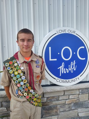Ian Palinkas, a Lake Middle High School student and member of Boy Scout Troop 330 of Green Valley United Methodist Church, installed printed vinyl flooring as a sensory walk at the Love Our Community's thrift store and warehouse, 1236 Sunnyside St. SW.