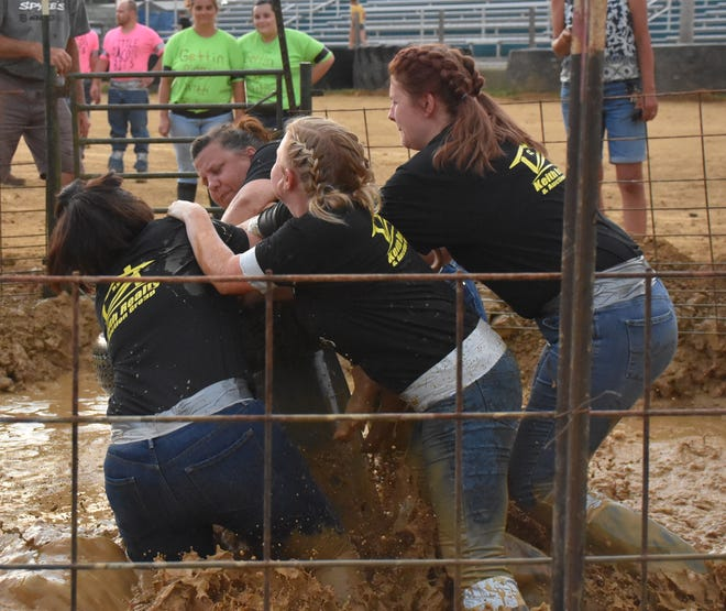 The Bacon Lovers team with members Alyssa Lunsford, Brittney Hogan, Santa Miller and Mandy Hall, won the girls over 19 age division with a time of 7.29 seconds.