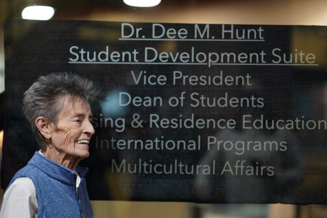 Dee Hunt stands outside of a suit named in her honor. Hunt passed away recently.