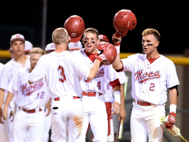 Florida Southern's Vaun Brown (4) and Pablo Cabrera (2) congratulate Cody Burgess (3) after he hit a two-run home run in the bottom of the 7th inning during their game against the University of Tampa at Henley Field in Lakeland on Friday, April 21, 2017.  Florida Southern came from behind to win 10-7.