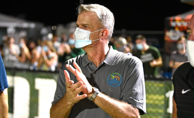 Sarasota County Schools new superintendent Dr. Brennan Asplen, seen here at a Venice High School football game, got top marks from the board in his year one evaluation.