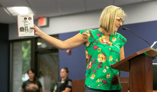"""Melissa Bakondy quotes lines from """"The Hate U Give"""" by Angie Thomas to the members of the Sarasota County School Board and Superintendent Brennan Asplen during an open meeting at the School Board of Sarasota County building. Concerned residents made their arguments in support of and against teaching critical race theory and wearing masks in school. MATT HOUSTON / HERALD-TRIBUNE"""