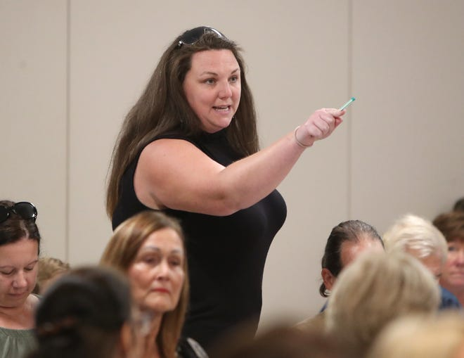 Ashely Cote directs comments towards members of the Sarasota County School Board and Superintendent Brennan Asplen during an open meeting at the School Board of Sarasota County building. Concerned residents made their arguments in support of and against teaching critical race theory and wearing masks in school. MATT HOUSTON / HERALD-TRIBUNE
