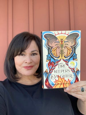 """Angeline Boulley, pictured with her young adult novel, """"Firekeeper's Daughter."""""""