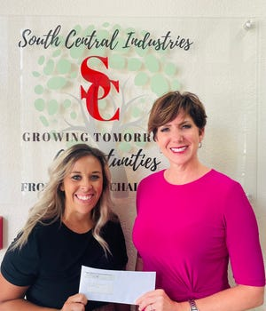 Canadian Valley Electric Cooperative, Inc., and Co-Bank just awarded South Central Industries with a $5,000 grant. Amber Himle, CVEC marketing director, at left, presents the funds to South Central Industries Executive Director Tina Hanna.