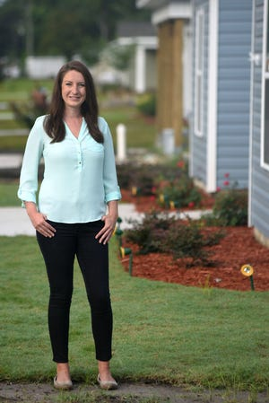 Lauren McKenzie, Executive Director of Cape Fear Habitat for Humanity, stands in front of several Habitat homes in Wilmington, N.C., Tuesday, July 13, 2021. McKenzie is one of the StarNews 40 Under 40 honorees for 2021.