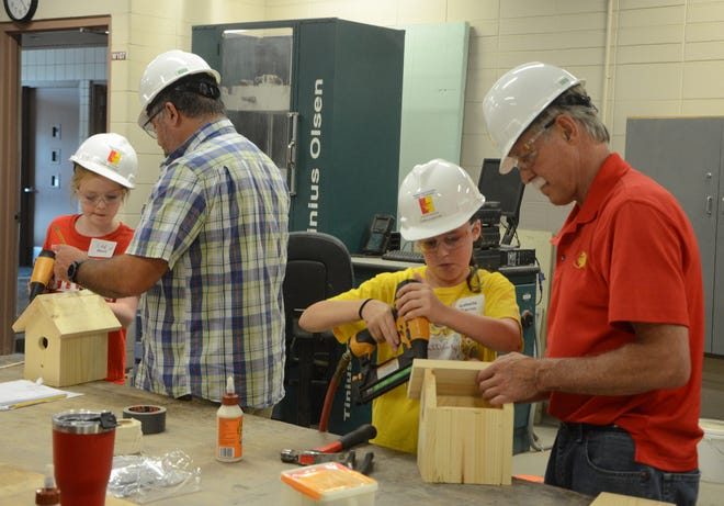 """Christian Anne Elizabeth """"CAE"""" Wood, left, and Izabelle Bacon build bird houses at Construct Your Future camp on Tuesday."""