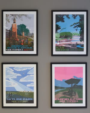 """Posters part of Parks and Green Spaces """"See Topeka"""" art project illustrate well-known Topeka parks in an exhibit at the Topeka and Shawnee County Public Library."""