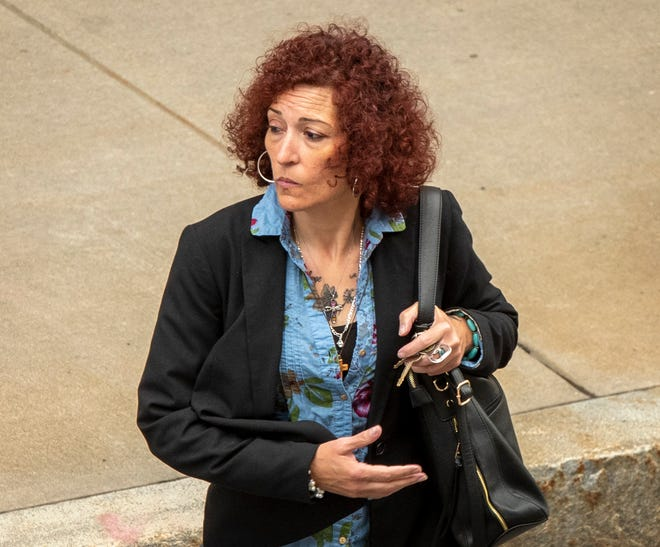Jacklyn M. Sutcivni — formerly Jacqueline M. Vachon-Jackson — leaves the Harold D. Donohue Federal Building Wednesday after the second day of her federal trial.