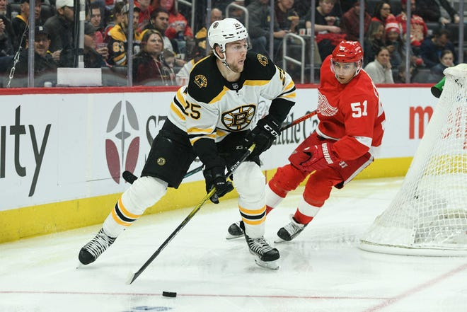 Defenseman Brandon Carlo will be sticking with the Bruins for a while.