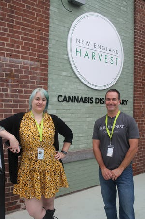 Outside New England Harvest cannabis dispensary are Kristen Petrie, director of communications and inventory manager, and Derek Armstrong, director of Operations.