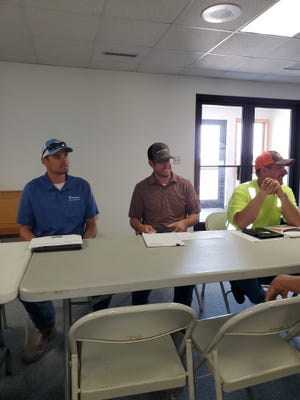 Community members heard from Justin Zylstra, project manager for Duininck Inc., Waylon Basius of Banner Associates and Codington County Highway Superintendent Rick Hartley at a recent community meeting in Waverly to discuss planned road repairs in the area.