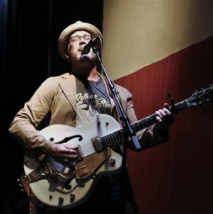 Chris Beall performs in Austin. Thirty years ago, he was the guitarist in an Abilene band called The Expense.
