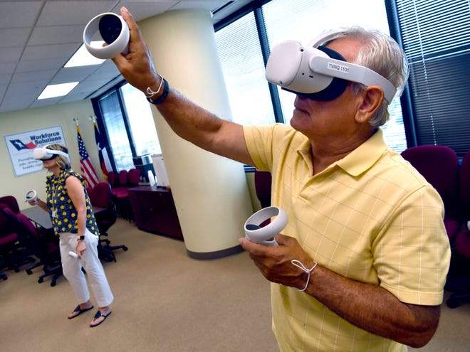 Bill Enriquez, member of the Abilene Independent School District board, tries out a virtual reality toolkit at Workforce Solutions of West Central Texas Wednesday.