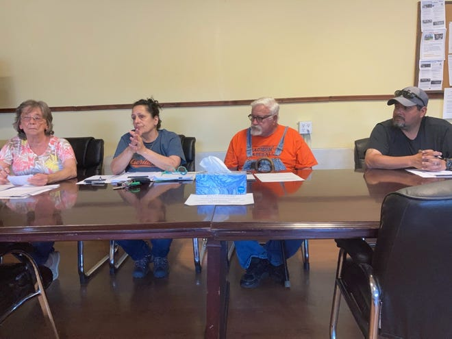 The Hot Springs Town Board of Aldermen hears a report from town maintenance employee Jeremy Grantham. The board voted to temporarily halt new sewer connections after usage rates were above state-mandated levels.