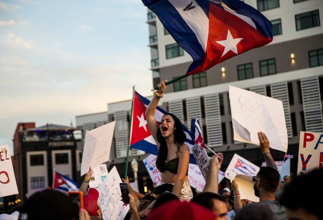 Cuban flags are raised and waved in downtown Fort Myers  on Tuesday, July 13, 2021 as part of a march demanding freedom for the Cuban people that are still in Cuba. The event in Fort Myers was called the Walk for Cuba. About a 1,000 people attended the event.